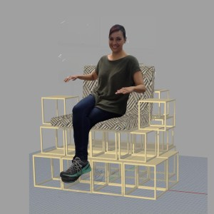 sitting in designed chair